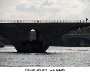 "View on the Rhone river in Avignon, southern France. The river is crossed by a famous medieval bridge called the ""Pont d'Avignon"" or ""Pont Saint-Bénézet"" in french (Avignon bridge in english)."