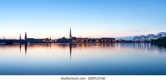 View on Riga cityline panorama in early morning over river Daugava. Panoramic montage from 11 images.