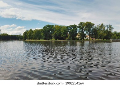View on ripple water surface from embankment of Upper Lake - artificial city pond, popular tourist attraction and leisure zone in Kaliningrad, Russia at sunny summer day