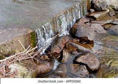 View on the river. Flowing water, stones and grass