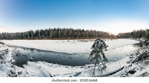 View on the river Gauja Valley covered with floating ice in deep winter. Cesis, Latvia.