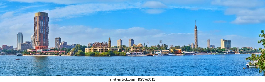 The view on the riverside quarters of Gezira Island with casinos, gardens, luxury hotels and Cairo Tower on background, Egypt.