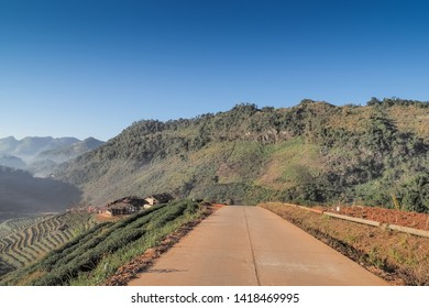 view on the road around with tea plantation, green mountain and blue sky background, Rai Cha 2000 Tea Plantation, Doi Ang Khang, Chiang Mai, northern of Thailand.