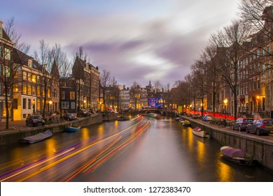 View on romantic canal Keizergracht  in Amsterdam at night with city light and reflection on water