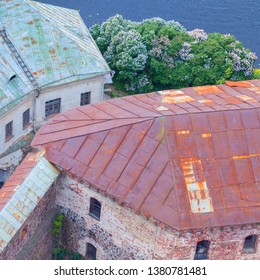 View on the roofs of Vyborg, Russia. Travel around old Russia. Spring in Vyborg.