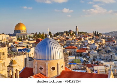 A view on rooftops of Old City of Jerusalem. Grey dome of Church of Our Lady of the Spasm (Armenian church) and golden Dome of the Rock.
