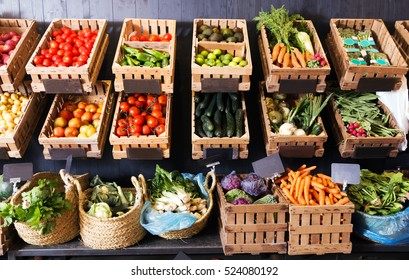 view on rustic containers with various fresh vegetables and fruits in supermarket