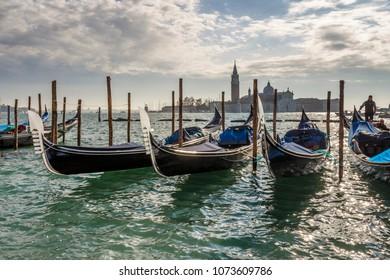 View on San Giorgio Maggiore island in Venice with gondolas in front