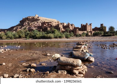 View on the sandbags helping to cross the river in front of the Kasbah Ait Ben Haddou near Ouarzazate in the Atlas Mountains of Morocco.