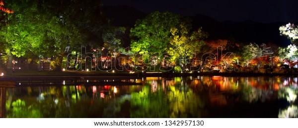 View on a Sarusawa pond during night autumn light up at Daikakuji temple, Kyoto