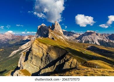 View on Seceda peak. Trentino Alto Adige, Dolomites Alps, South Tyrol, Italy. Odle mountain range, Val Gardena. Majestic Furchetta peak. Odles group seen from Seceda, Santa Cristina Val Gardena.