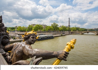 View on Seine River and Eiffel Tower from Alexander III bridge (pont Alexandre III) in Paris, France.