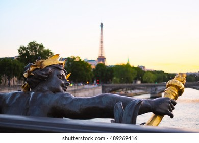 View on Seine River and Eiffel Tower from Alexander III bridge (pont Alexandre III) in Paris, France. Sunset light.