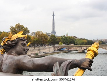 View on Seine River and Eiffel Tower from Alexander III bridge in Paris, France.  It is the most extravagant bridge in Paris.