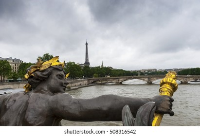 View on Seine river and Eiffel Tower from Alexander III Bridge on a gloomy day