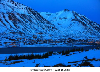 View on Siglufjordur at dusk in winter, northern coast of Iceland.