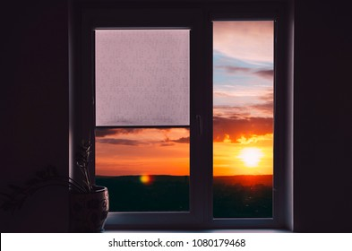 View on sky in sunset time from home window