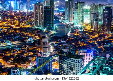 View on the Skyline of Makati at night in Manila, Philippines.