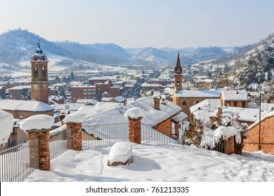 View on small italian town covered with snow in Piedmont, Northern Italy.