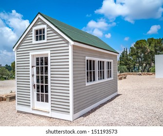 view on small wooden white house