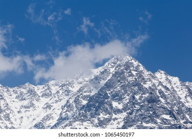 view on snowy Dhauladhar peak in Himalayas from Dharamshala, India
