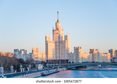 View on the Stalin skyscraper on the Kotelnicheskaya embankment of Moskva-river in the rays of the setting sun and. Winter cityscape. Blurred background