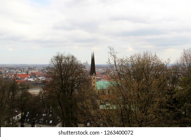 view on a steeple at the sparrenburg in bielefeld germany photographed during a sightseeing tour at a sunny day