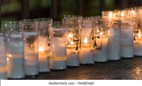 View on the table with candles in Tarragona Cathedral (Catholic cathedral), Catalunya, Spain. Close-up