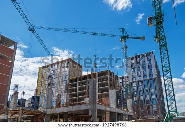 view-on-three-tower-cranes-600w-19274987