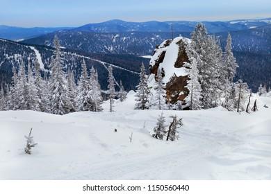 View on top of  Mount Utuya. Winter landscape in Altay Mountains. Siberia, Kemerovo region, Sheregesh ski resort, March 2018.