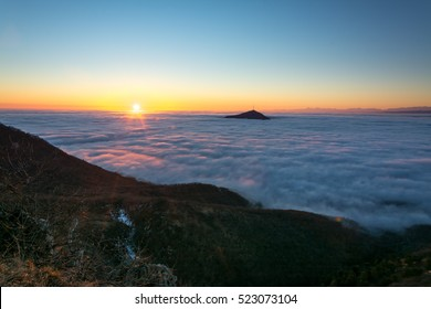 View on the top of the mountain Mashuk above the clouds. Behind you can see the chain of the Great Caucasus Range.