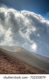 View from on top of the Volcano Mount Etna in Sicily, Italy on a cloudy Autumn day.