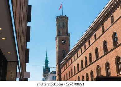 View on towers of Hamburg, Germany  Alte (old) Post and Rathhaus (townhall) from the Poststrasse street in Passagenviertel (passage quarter) on a blue sky background - Shutterstock ID 1996708991