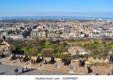 View on the town center and streets of the Edinburgh city,princess street gardens and coast from the castle, people watching landscape, sunny spring day, central park landscape, scottish capital