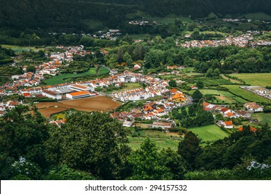 View on town of Furnas, located in the same name a civil parish in the municipality of Povoacao on the island of Sao Miguel in the Portuguese Azores, as seen from the Pico do Gaspar Belvedere.