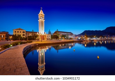 View on town hall and Saint Dionysios Church, Ionian Sea, Zakynthos island, Greece, Europe. Amazing sunset view. Zakynthos tower in the evening lights. The main harbor of the city. Sunrise.