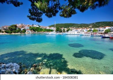 View on traditional greek town with whitewashed houses on Skiathos island, Sporades archipelago, Greece