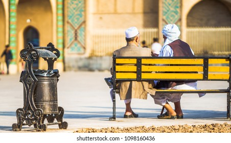 View on two old man sitting on bench in Yazd - Iran