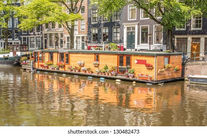 View on a typical canal in Amsterdam, the Netherlands, with houseboats