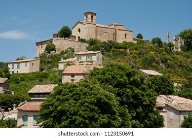 View on typical village in France Provence in summer. Church on top of the hill.