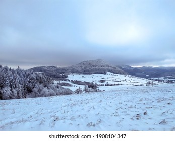 View on the valley covered with snow and frozen forest from mountain trail in Sowie gory - Shutterstock ID 1908104347
