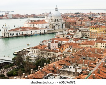 The view on Venice roofs and Santa Maria della Salute Cathedral from San Marco Campenile bell tower