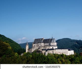 View on Vianden Castle from Hill in Sunny Day on Blue Sky background. Luxembourg, Benelux