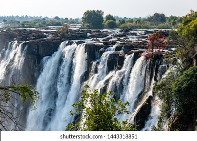 View on the victoria falls from zambia in high water season wit ablue sky, africa