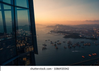 View on Victoria's Bay from the tallest building in Kowloon with transparent glass windows
