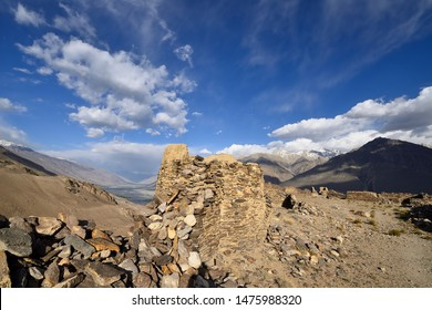 View on the Wakhan Valley in the Pamir mountain, The ruins of the Yamchun Fort and the white Hindu Kush range in Afghanistan, Tajikistan, Central Asia