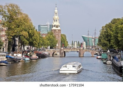 View on the watertower with cruiseboat in Amsterdam the Netherlands