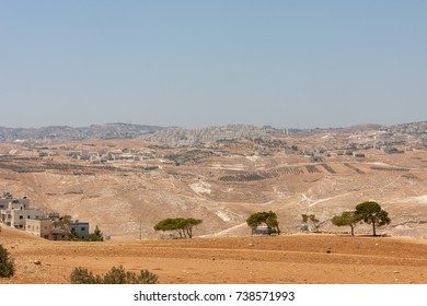 View on white buildings of Har Homa East Jerusalem district from Beit Sahour. Judean desert, Palestine, Israel.