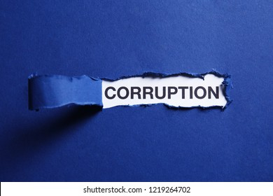 View on word CORRUPTION through torn paper