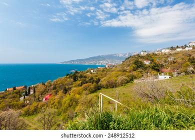 View on Yalta city and Ai-Petri mountain from Nikita settlement in Crimea, Ukraine. Russia